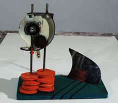 Sliced Dreams (2011)  by Chris Lockhart acrylic paint, plywood, food slicer parts