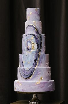 Featured Cake: Nadia & Co; Beautifully unique purple wedding cake with artistic detail