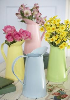 love these combinations , the yellow flowers would look lovely in the blue pitcher too