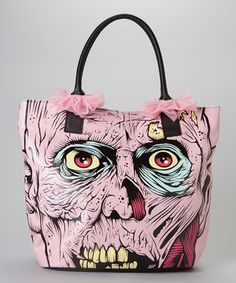 With inspiration from scary movies, this spooky tote will have the undead dancing out of their graves! Detailed with two feminine pink bows, it's a zombie lover's dream.