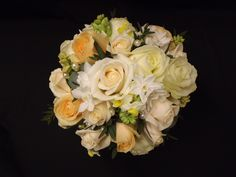 spring style hand tied bouquet  with roses, paper whites and narcissi hand tied with pearl detail www.weddingflowersbylaura.com