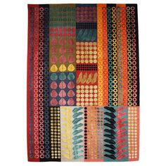 Margo Selby - Fibonacci Earthy Rug  Different sizes of shapes across the piece but all within the same colour palette