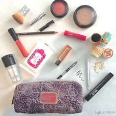 This makeup bag spill is DEFINETELY full of desert island makeup must haves!