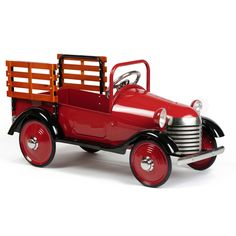 I can't even tell you how much I love metal pedal cars. They just seem so classic to me. This one found on PoshTots.com