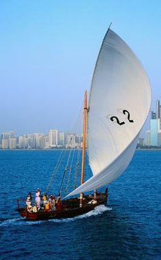 A racing Dhow enters the breakwater of the Corniche - Abu Dhabi