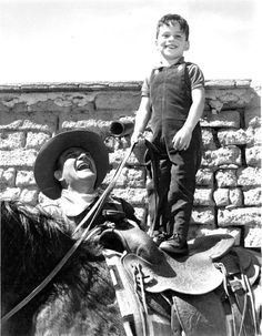 The Duke With son Ethan on the set of The Sons of Katie Elder, 1965