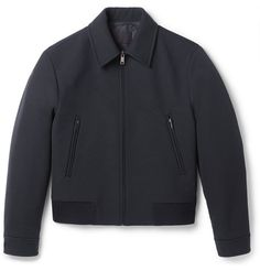 Prada's bomber jacket has been impeccably crafted in Italy from hard-wearing gabardine and is lightly padded to optimise insulation. It's finished with a ribbed-knit hem which gives it an athletic feel, while the easy-to-wear navy hue ensures it will work with countless outfits. Throw it on over a lightweight rollneck sweater.