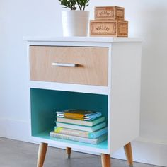 Check out this before and after of a dated nightstand to a modern vintage side table using paint, wood veneer and new hardware.