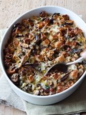 "Mushroom & Leek Bread Pudding by Barefoot Contessa My brother makes this as our holiday ""stuffing"" every year and it is SOOO good! He's made it so many times that it looks so easy to make! I will try it out myself for sure!"