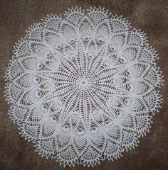Finished Doily   This is the final doily that will be a pattern of the month in 2011 on my yahoo group. It's been tested by several people, ...