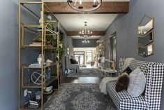 Masters of Flip luxe lodge front hall checkered bench seats and gold bookcases Dream House Plans, My Dream Home, Masters Of Flip, House Flippers, Interior Styling, Interior Design, Wooden Dining Room Chairs, Home Reno, Plan Design