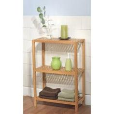 @Overstock.com - Bamboo 3-Tier Shelf - Store more in your bathroom with this durable solid bamboo shelf. The units three separate tiers allow you to make the most of potentially limited floor space, and its straightforward natural wood finish will suit most bathroom decor.  http://www.overstock.com/Home-Garden/Bamboo-3-Tier-Shelf/6457626/product.html?CID=214117 $49.49