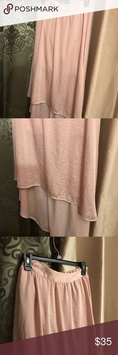 Never worn beautiful silk skirt Elastic in the back waist, long and flowing, pretty silk light pink in color. Hangs longer on one side. Love it!! LC Lauren Conrad Skirts Asymmetrical