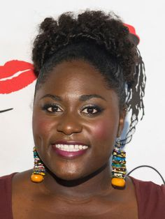 Once hair has a little more length, pile it loosely across your crown for an easy, flirty look, like Danielle Brooks.