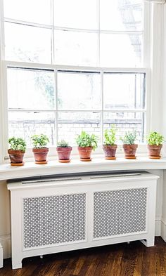 We love this simple set up of potted plants along the windowsill.