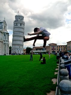 Forced perspective - He is not going to push it back up, he is going to kick it down!