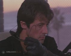 Sylvester Stallone Cobra Movie | Sylvester Stallone taking off his Ray-Ban 3030 Outdoorsman sunglasses ...