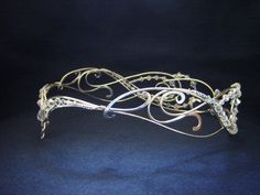 This crown was created based on the original MoonRay circlet design. Per the customer's request, it was created with a closed back