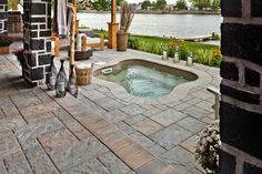 The natural-looking products of this space mixed with rugged textures help transport us to a country rustic feel. Blu60 slab by Techo-Bloc in Champlain Grey. www.techo-bloc.com www.facebook.com/techobloc