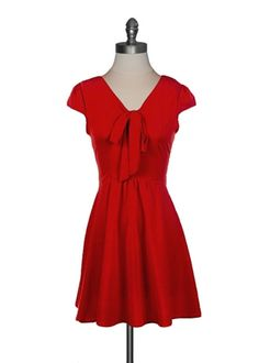 Classic A-line dress with a full flared skirt and v-neckline with bow tie closure