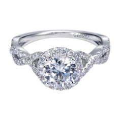 Gabriel & Co. 14K White Gold Contemporary Halo Engagement Ring available at Harrison Jewelers.