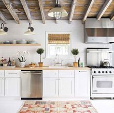 farmhouse kitchen with exposed ceiling