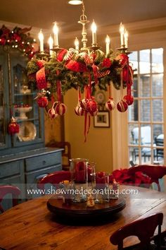 Garland & Christmas ornaments on chandelier over table!