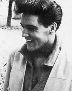 Elvis Presley is pictured on the front porch of Graceland in Memphis, TN on Wednesday, March 9, 1960. He was given an RCA TV set to mark 50 million record sales. Also see these photos: https://www.pinterest.de/pin/380906080974222901/ and https://www.pinterest.de/pin/380906080974237546/