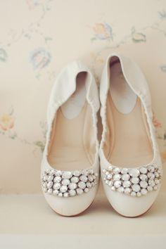 Bejeweled white flats for wedding day comfort. #weddingflats #bride #weddingchicks Shoe Design: Nine West ---> http://www.weddingchicks.com/2014/04/29/family-farmhouse-wedding-retreat/