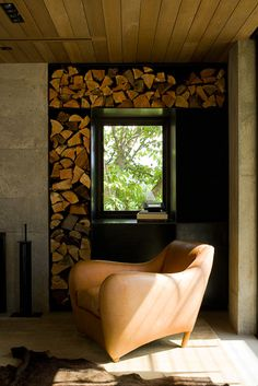 home residential living room chopped wood concrete fireplace balzac chair balzac lounge chair designer