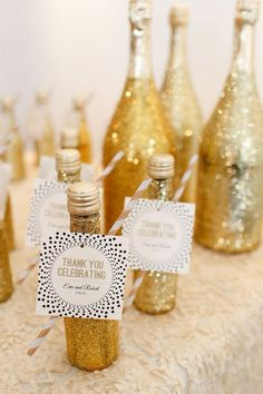 small gold glittered wedding favor champagne bottles - photo by Jenn Finazzo Photography