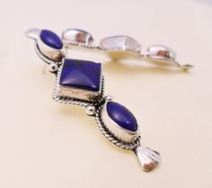 Navajo crafted earrings highlighting three natural lapis stones in sterling silver.    www.EagleDancerGallery.com