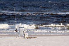 Chair and fishing gear on an the Alabama Gulf coast.