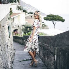 Mary Seng of Happily Grey explores Positano, Italy in Ann Taylor's Floral Lace Midi Dress.