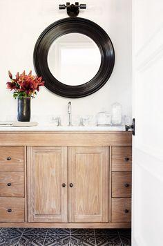 Cérused wood cabinetry inside a bathroom