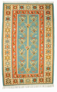 A Chiprovski rug (traditional Bulgarian style of area rugs) with a stylized bird motif