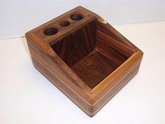 Vape Desktop Organizer  $39.99  Handmade in Texas from select Walnut and Pecan hardwoods Dimensions are 6″x5″x3″ (LxWxH). The open tray can hold your juice bottles, tanks, tips, coils, or your favorite accessories. Three battery bays with 1″ openings. Some images shown are past custom orders to show color variances.