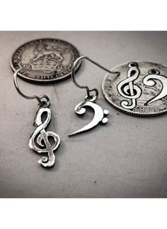 handmade bass and treble clef silver earrings made from recycled silver coins