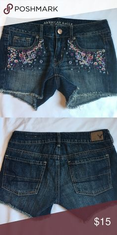 """American Eagle Floral Shorts American Eagle Denim Midi Festival Short These shorts are 100% cotton denim. Cut-off style. Midi length - 4"""" inseam. Low rise. Embroidered flower detail on front. Like New American Eagle Outfitters Shorts Jean Shorts"""