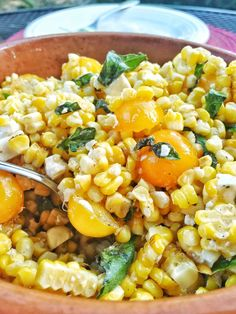 Charred Corn and Feta Salad: a delicious corn salad with only a few ingredients and great flavor. Sweet corn, salty feta, juicy cherry tomatoes and fresh basil.