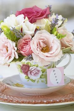 """Pretty Tea Party idea - fill a tea cup with pretty roses in all shades of pink for a centerpiece or for a personal favor and place """"card."""""""