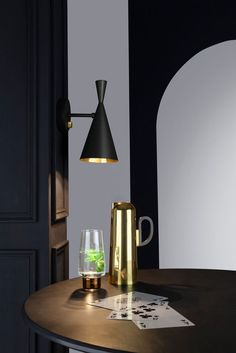 Tom Dixon's BEAT Light.  Made from spun brass, the Beat wall light incorporates the familiar hand beaten shade with a solid brass dimmer dial and can be adjusted to direct the light beam.  #tomdixon #tomdixonBEAT #surfacelights #surfacelighting #walllighting #walllights #inspiration #design #interior #interiordecoration