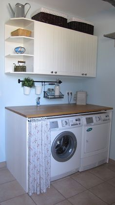 Hide the washing machine and the dryer behind a pretty curtain!
