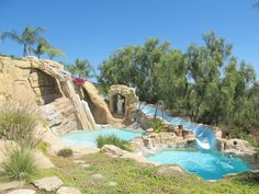 WE'D NEVER LEAVE lol. Pool and waterfall provide a beautiful backdrop for any event. Vacation Places, Best Vacations, Vacation Spots, Malibu Mansion, Dream Pools, Cool Pools, Ideal Home, Backdrops, Waterfall