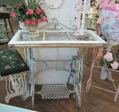 I love this.  Old treadle base+old window= Voila!  Beautiful table.