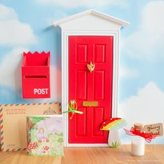 A darling bright red Fairy Door with Toadstool, hand-painted in rainbow colours that shimmer in the light. Includes a personalised letter from the Fairies.