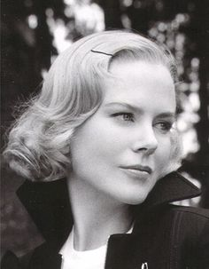"I think it's important that we don't all have to hold our heads high all the time saying everything's fine."" -Nicole Kidman."