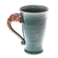 Buy Celadon ceramic mug, 'Elephant Handle in Green' today. Shop unique, award-winning Artisan treasures by NOVICA, the Impact Marketplace. Each original piece goes through a certification process to guarantee best value and premium quality. Pottery Mugs, Pottery Art, Thailand Elephants, Elephant Head, Meet The Artist, Autumn Fashion Casual, Dinnerware, Artisan, Handle