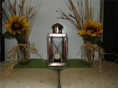 Wheat and sunflower in mason jar for walking down the isle?