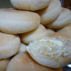 """English Muffins.  Better than store bought.   Subbed soy for milk, sunflower oil for shortening and only used 5 1/4 cups of flour.  Rolled into log and sliced into 24-1/2 """" pieces. Baked at 200C or 400F for 10 minutes on parchment paper sprinkled with cornmeal."""